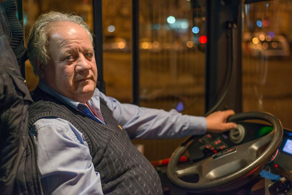 Oleg Khutsilava, one of the bus drivers, has mixed feelings about having homeless people on his bus. Even though they can cause trouble, they are still people — 'even the stray dogs have more rights then they do', he says. (Tamuna Chkareuli/OC Media)