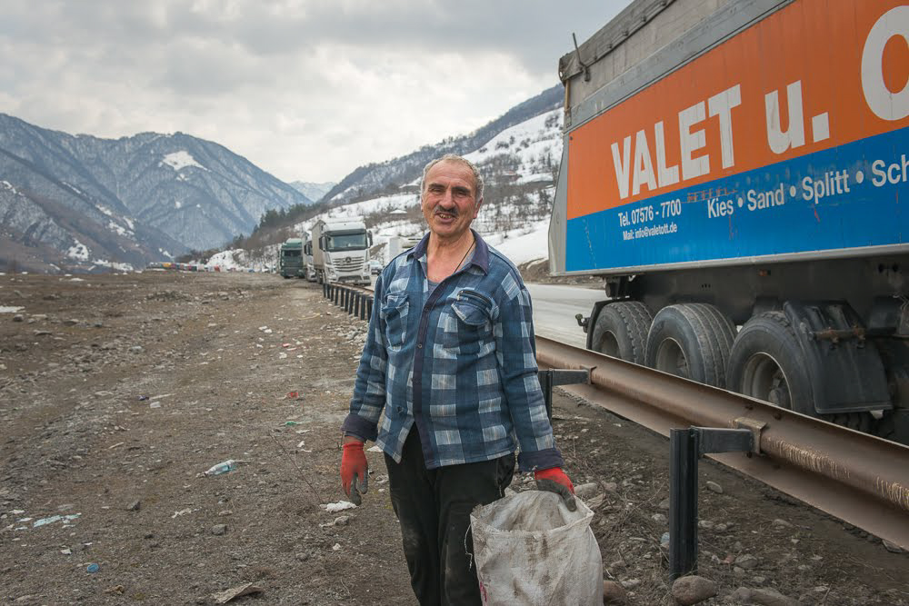 Arsena Kavtarashvili, 71, is proud of his job, one that young people have refused to take: 'There's nothing to be ashamed of here'. (Tamuna Chkareuli / OC Media)