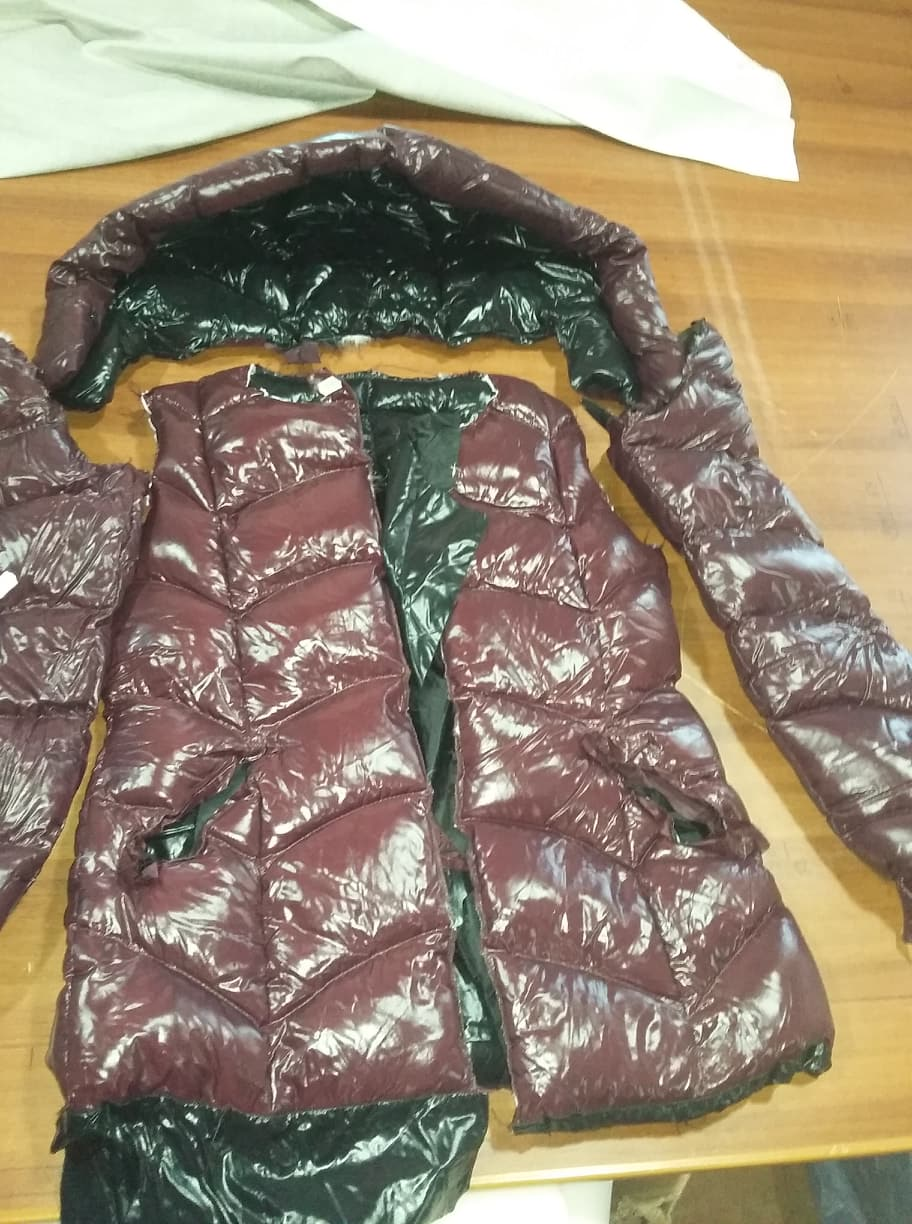 An anonymous employee gave OC Media photos of coat components, smuggled outside of the factory.
