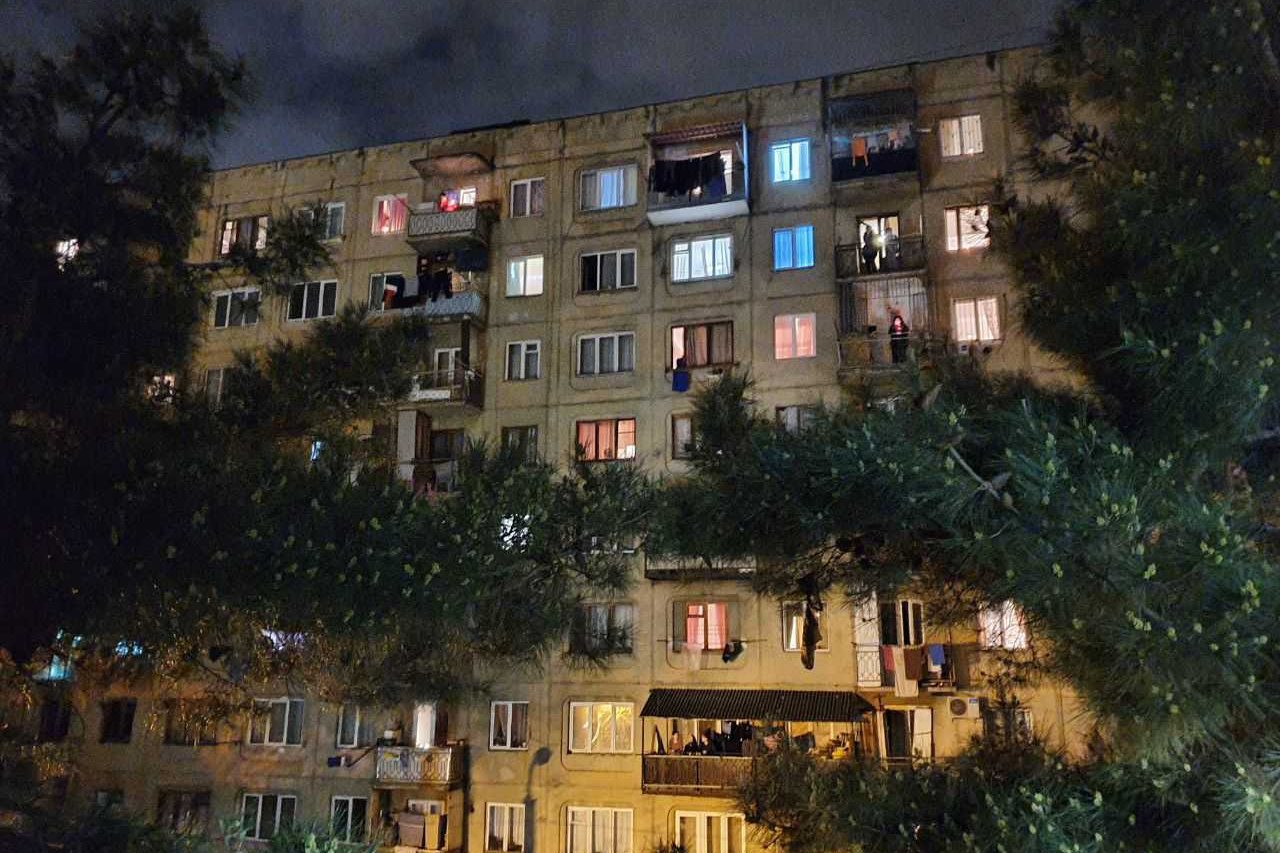 Many who didn't attend church services lit candles on their balconies. Photo: Dato Parulava/OC Media.
