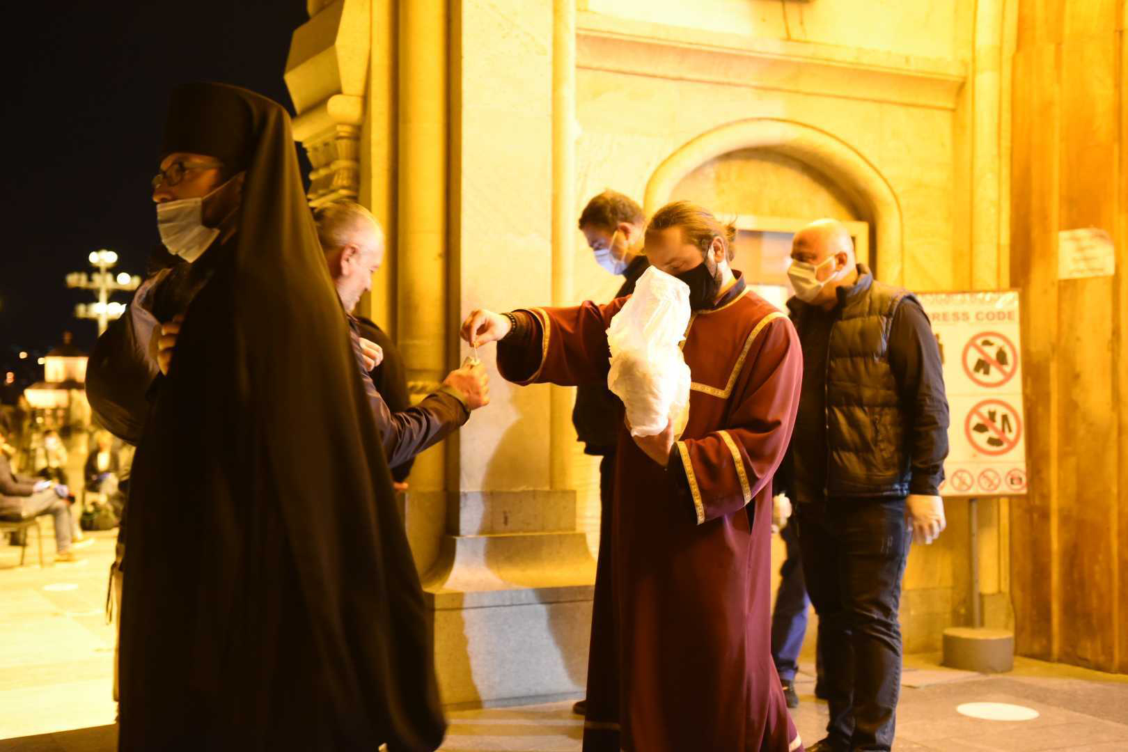 Clergy handed out facemasks to people entering the Church. Photo: Mariam Nikuradze/OC Media.
