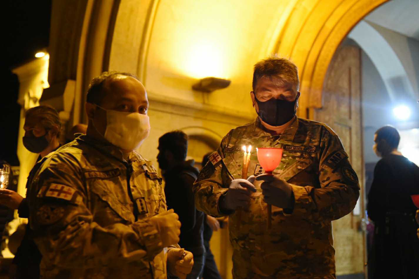 Soldiers lighting candles at Sameba Trinity Cathedral. Photo: Mariam Nikuradze/OC Media.