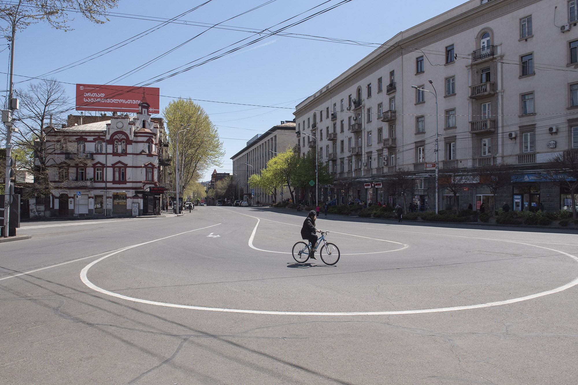 A girl cycling near the concert hall. Photo: Mariam Nikuradze/OC Media