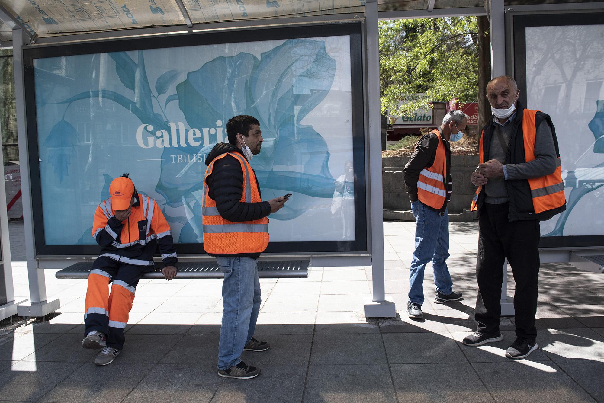 Street cleaners on a break near Freedom Square metro station. Photo: Mariam Nikuradze/OC Media