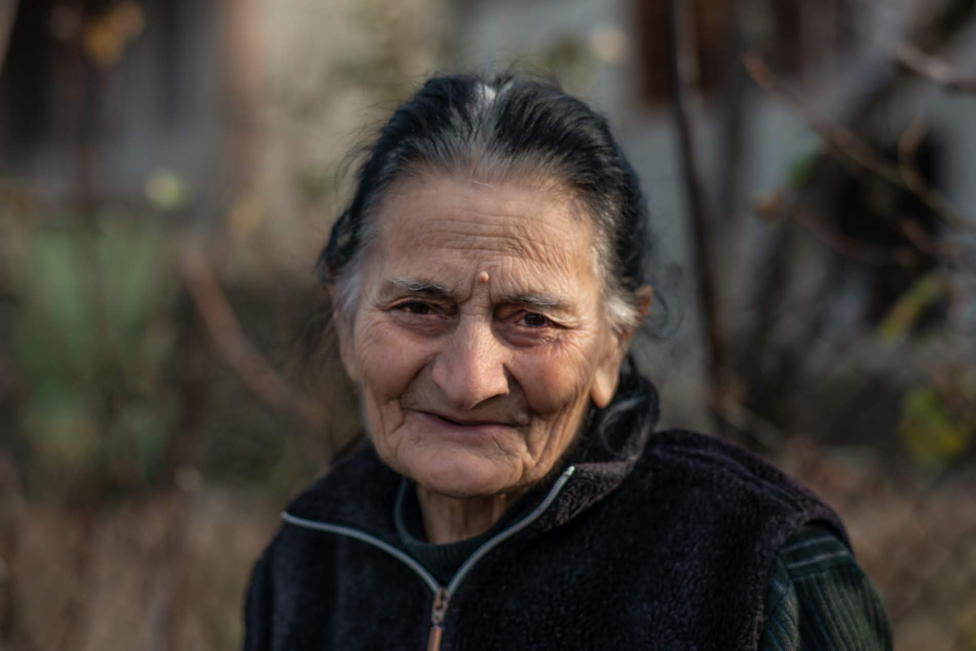 Nunu Natenadze, 81, was the first woman beekeeper in the village. She lives with Lali and helps her take care of the bees.  Photo: Tamuna Chkareuli/OC Media.
