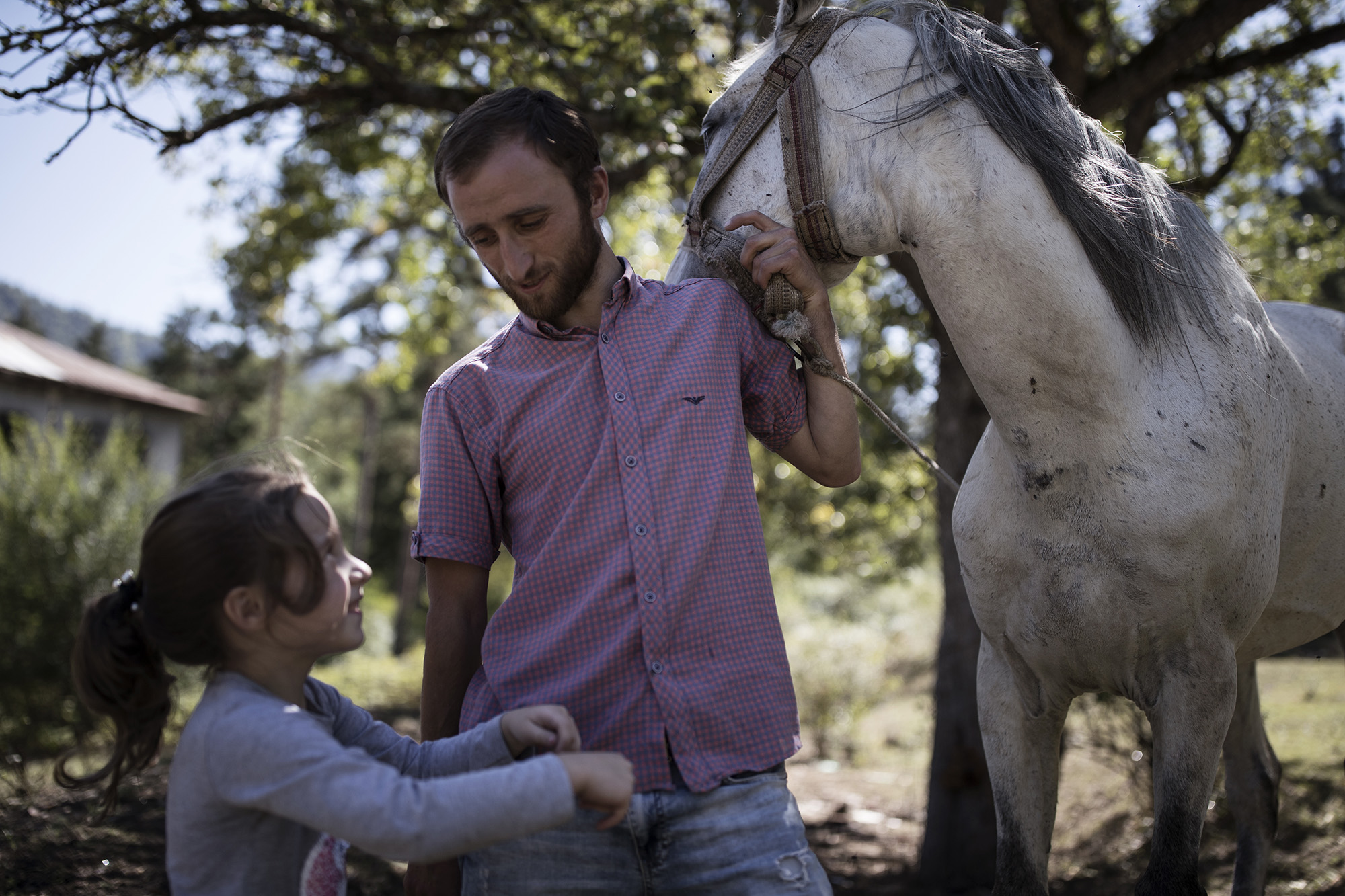 Jemal Ghonghadze with his daughter and horse in Likani. Photo: Ekaterina Anchevskaya/OC Media.