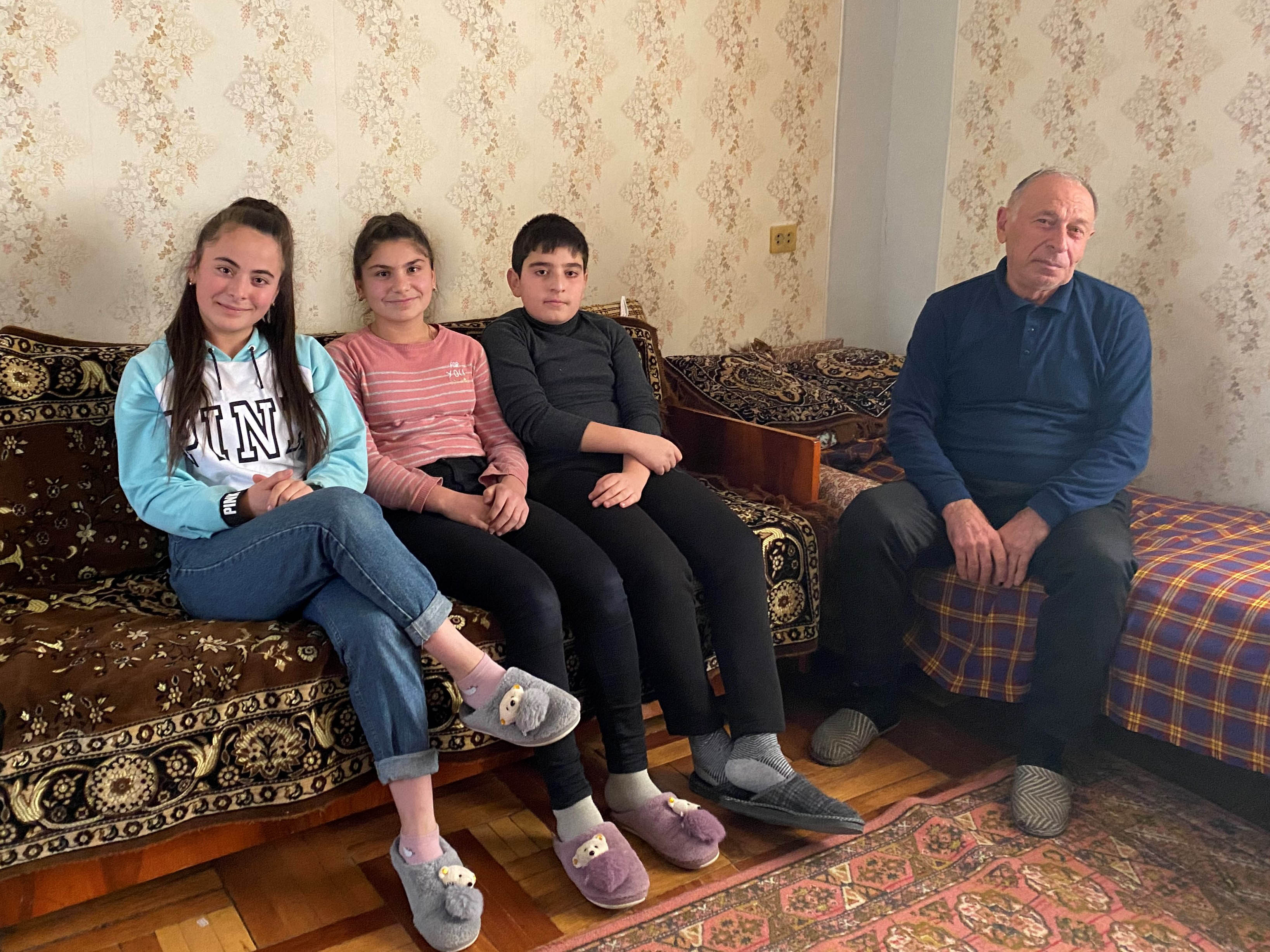 Zhora Poghosyan with his grandchildren. Photo: Dvin Titizian/OC Media.