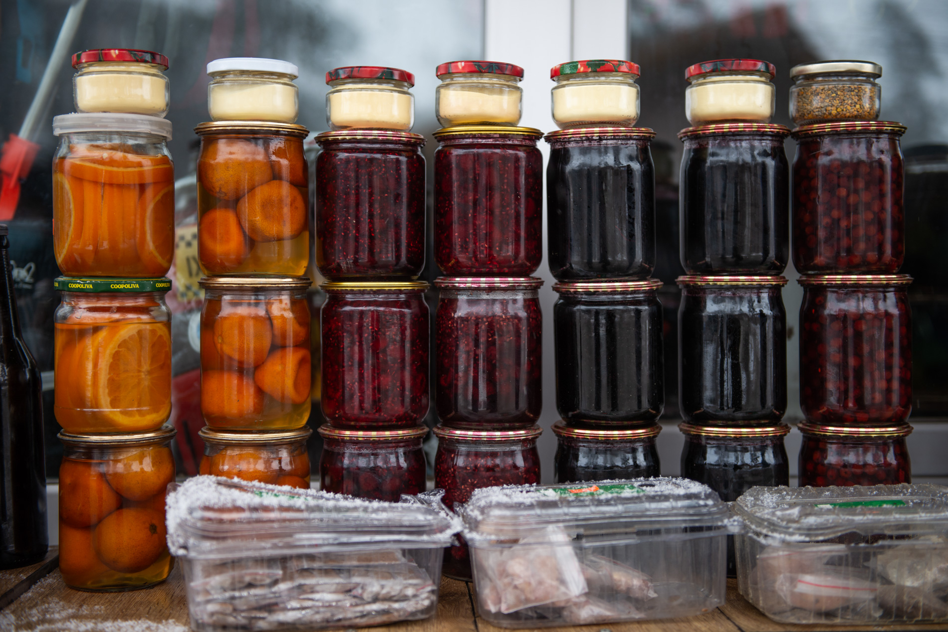Naira Kurmashvili has been selling Bakuriani delicacies for the last thirty years. One jar costs ₾10 [$3], and her income depends on how many of those she'll sell. Photo: Tamuna Chkareuli/OC Media.
