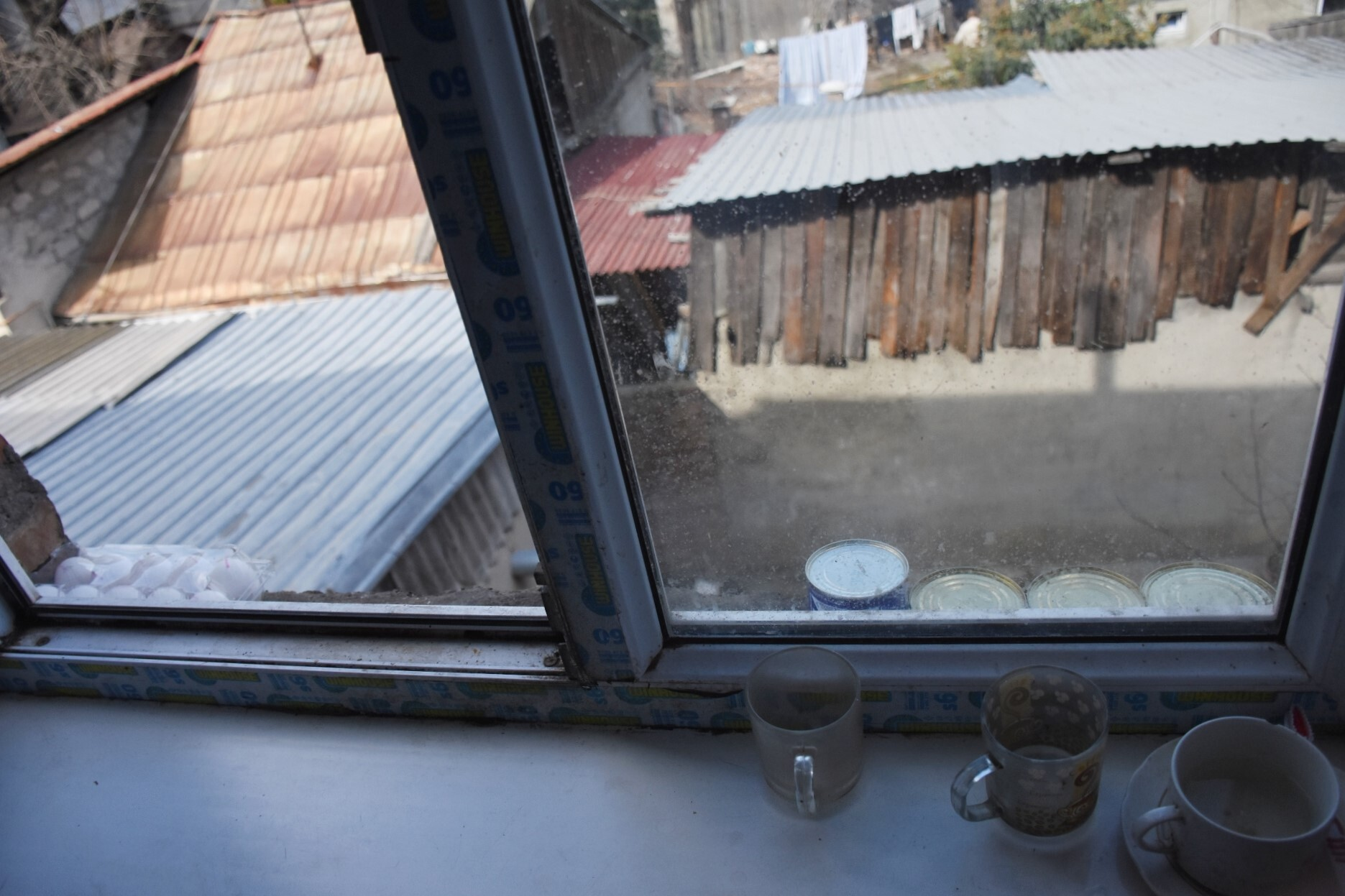 Sandro stores food on the window ledge as he does not have a refrigerator. Photo: Tata Shoshiashvili/OC Media.