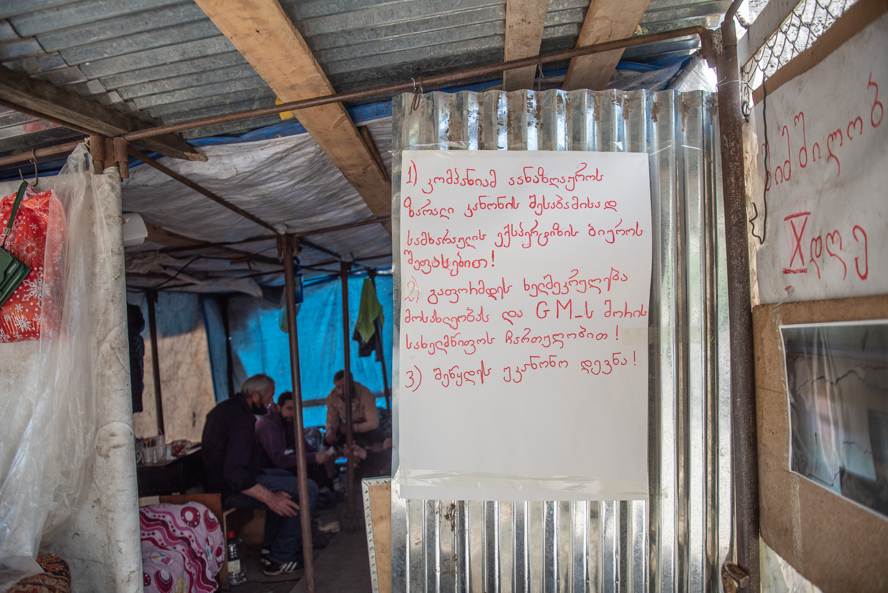 The protesters' demands posted at the entrance of the protest camp. Photo: Mariam Nikuradze/OC Media.