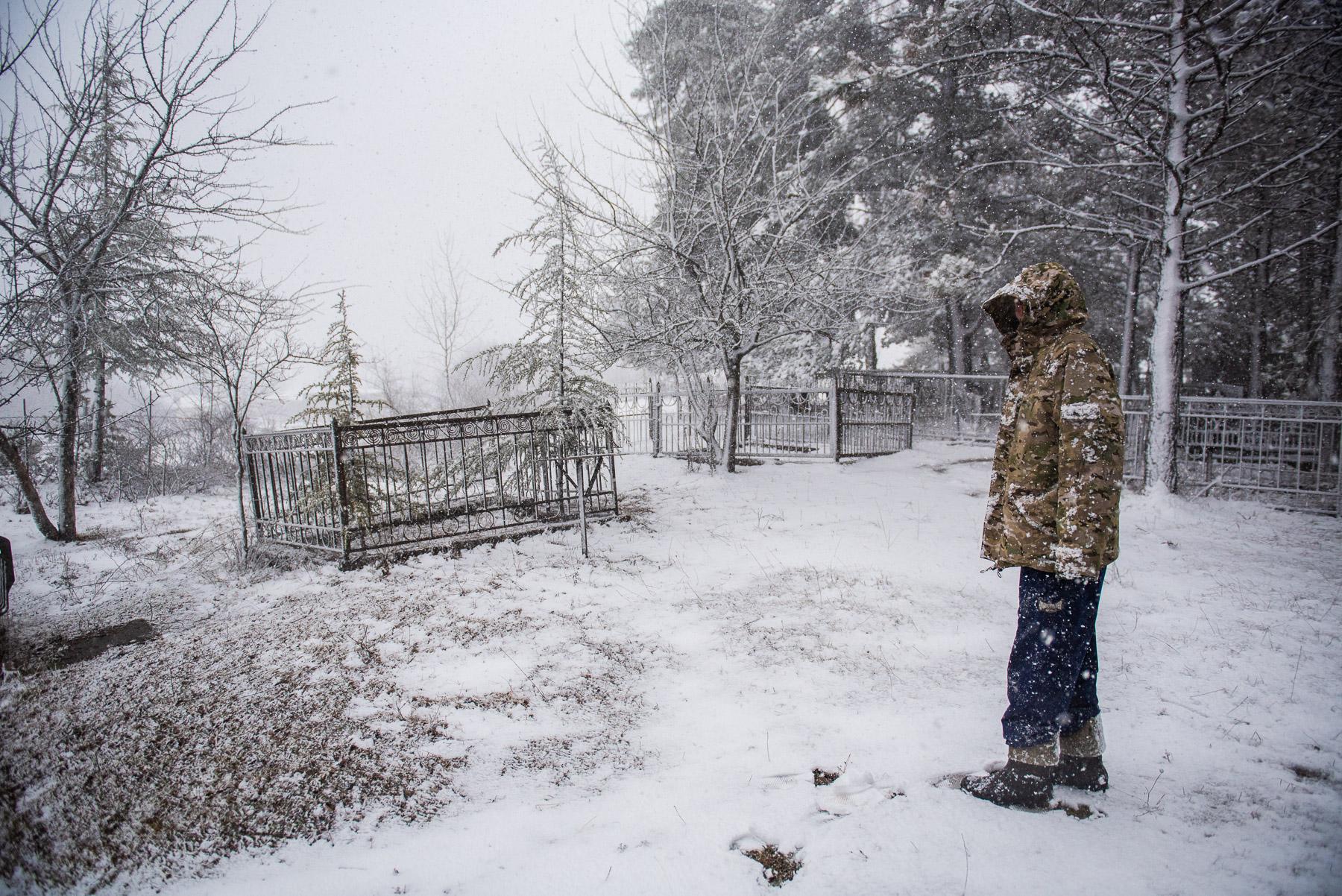 Levan Shekiladze shows graves that have been damaged in Shukruti. February 2020. Photo: Mariam Nikuradze/OC Media.